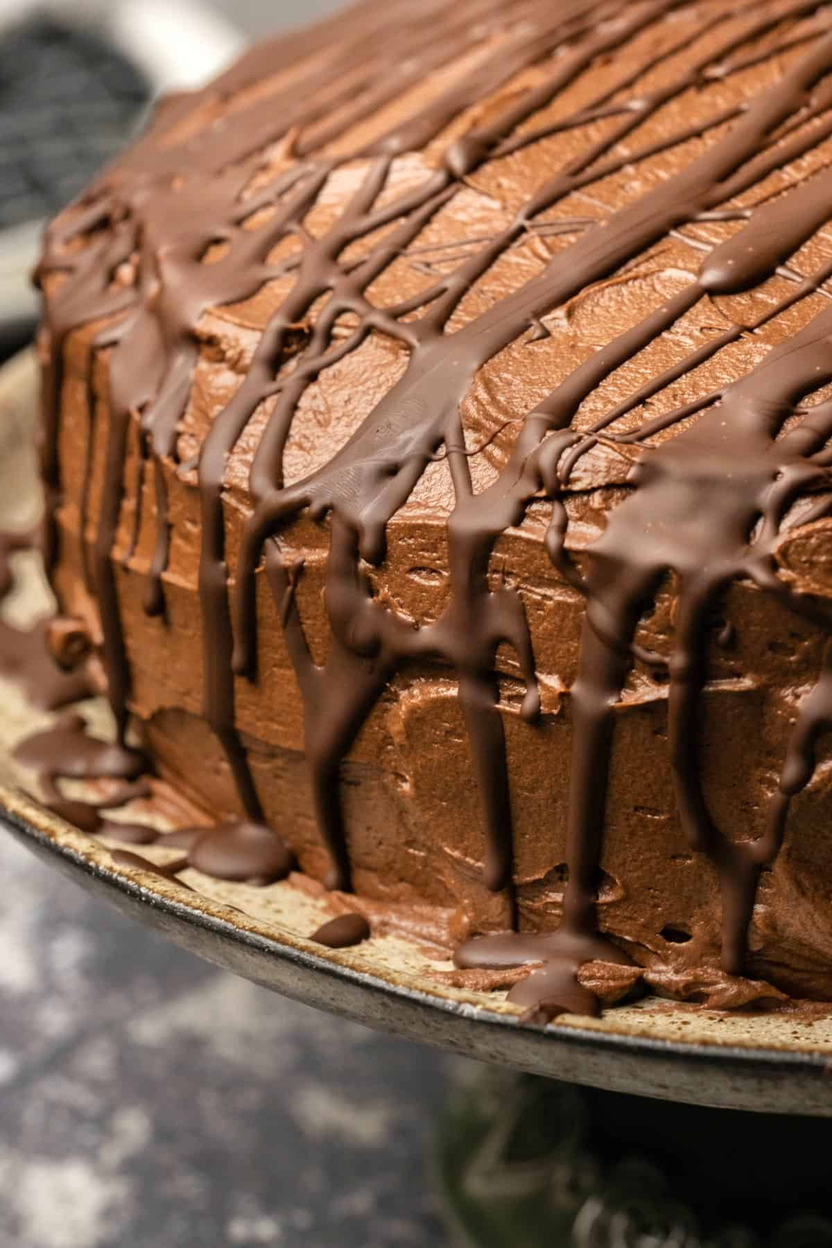 Chocolate buttercream frosting and chocolate decoration on a chocolate cake.