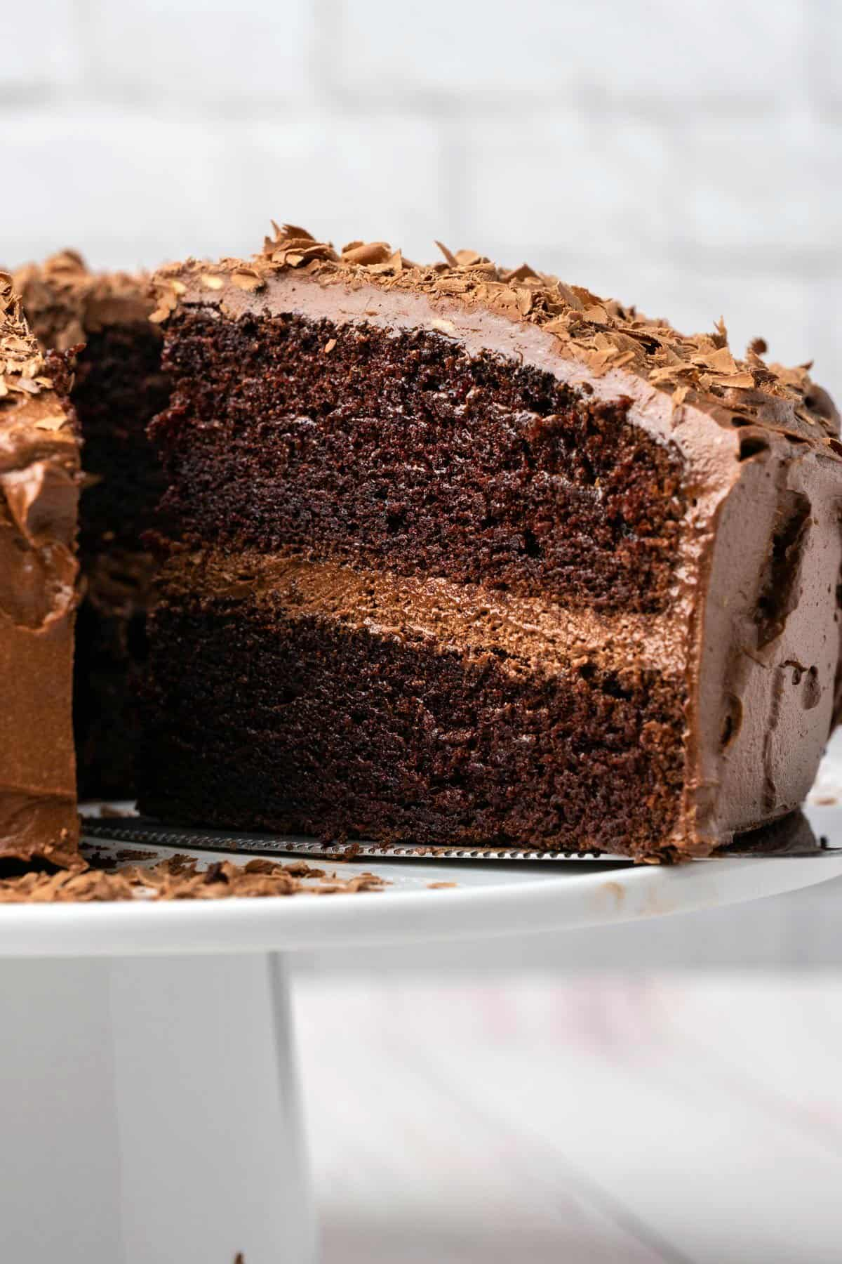 Slice of chocolate cake on a cake lifter.