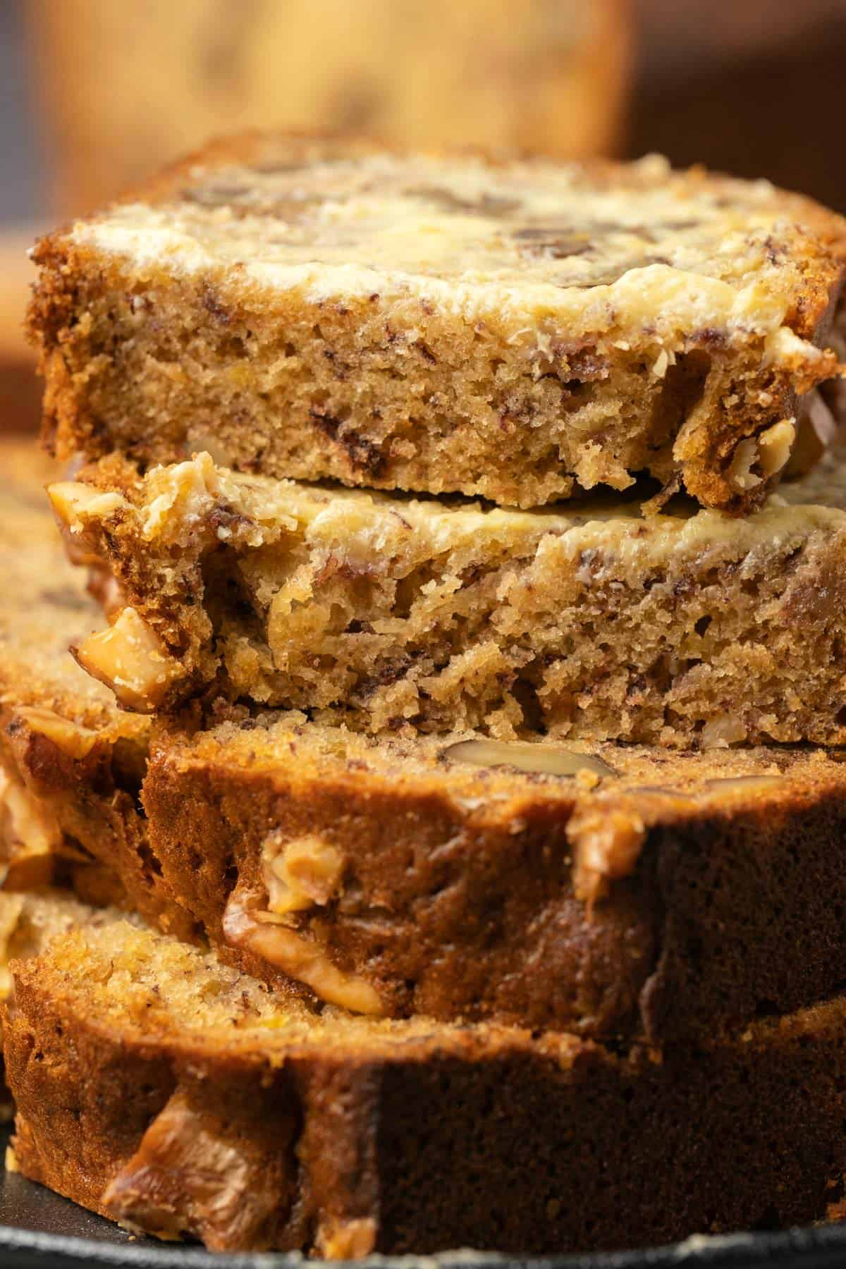 Slices of buttered banana bread in a stack.