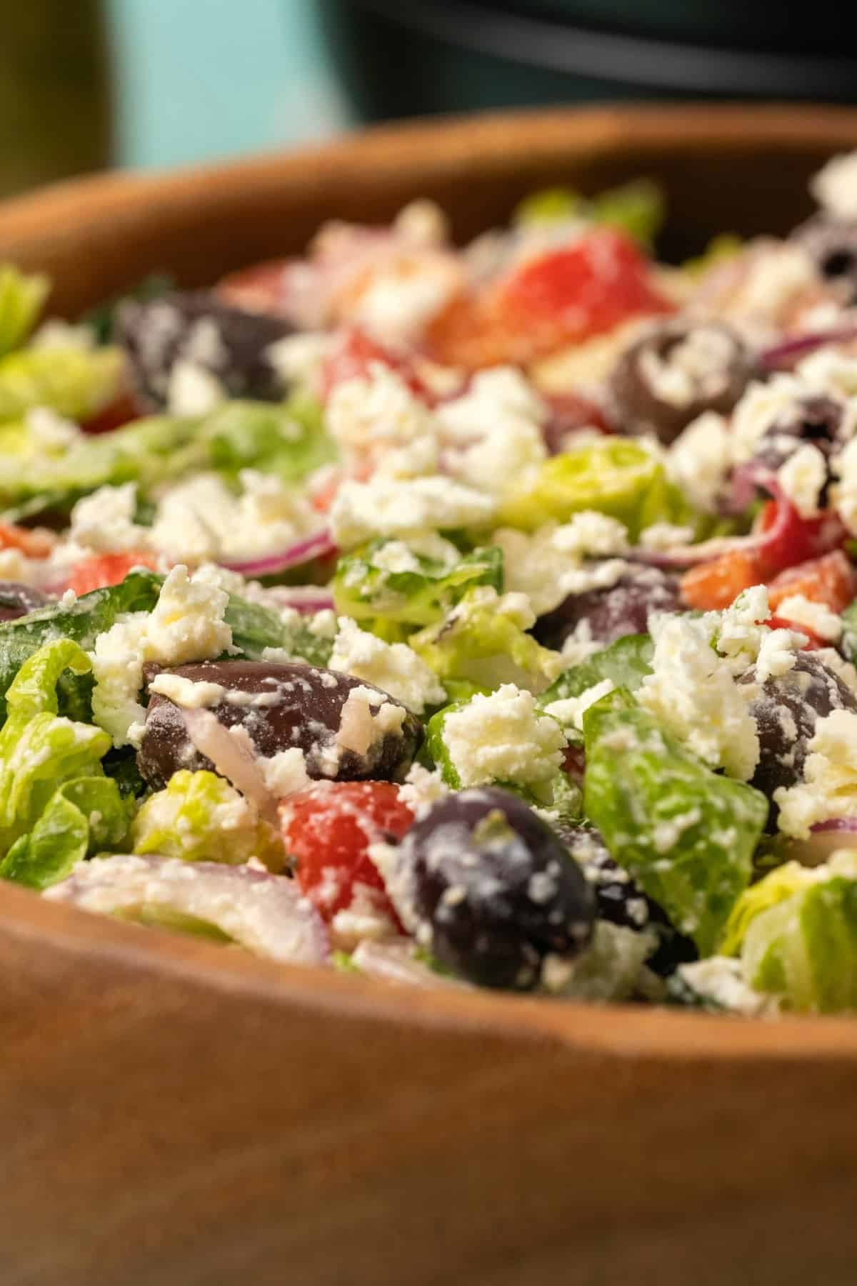Greek salad topped with crumbled feta cheese.