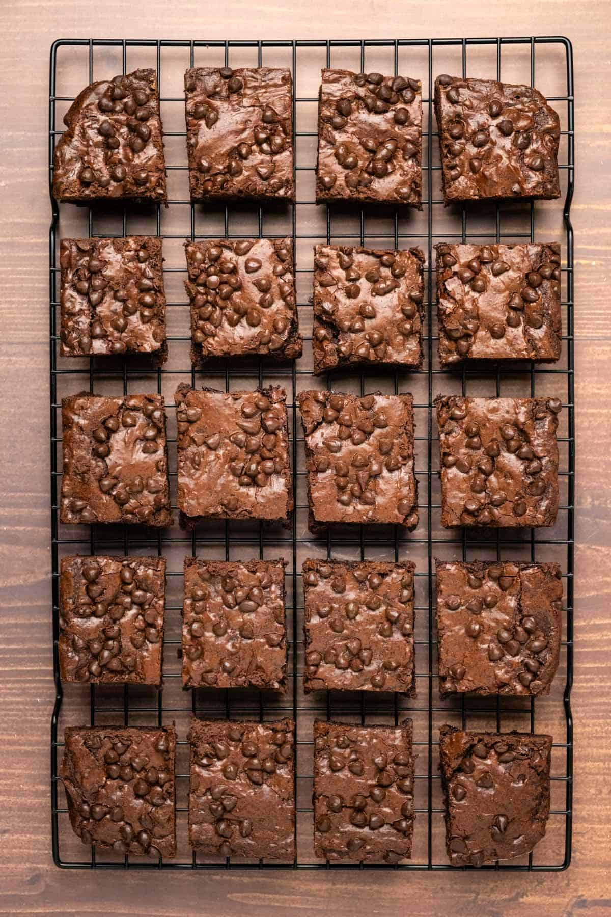 Brownies cut into squares on a wire cooling rack.