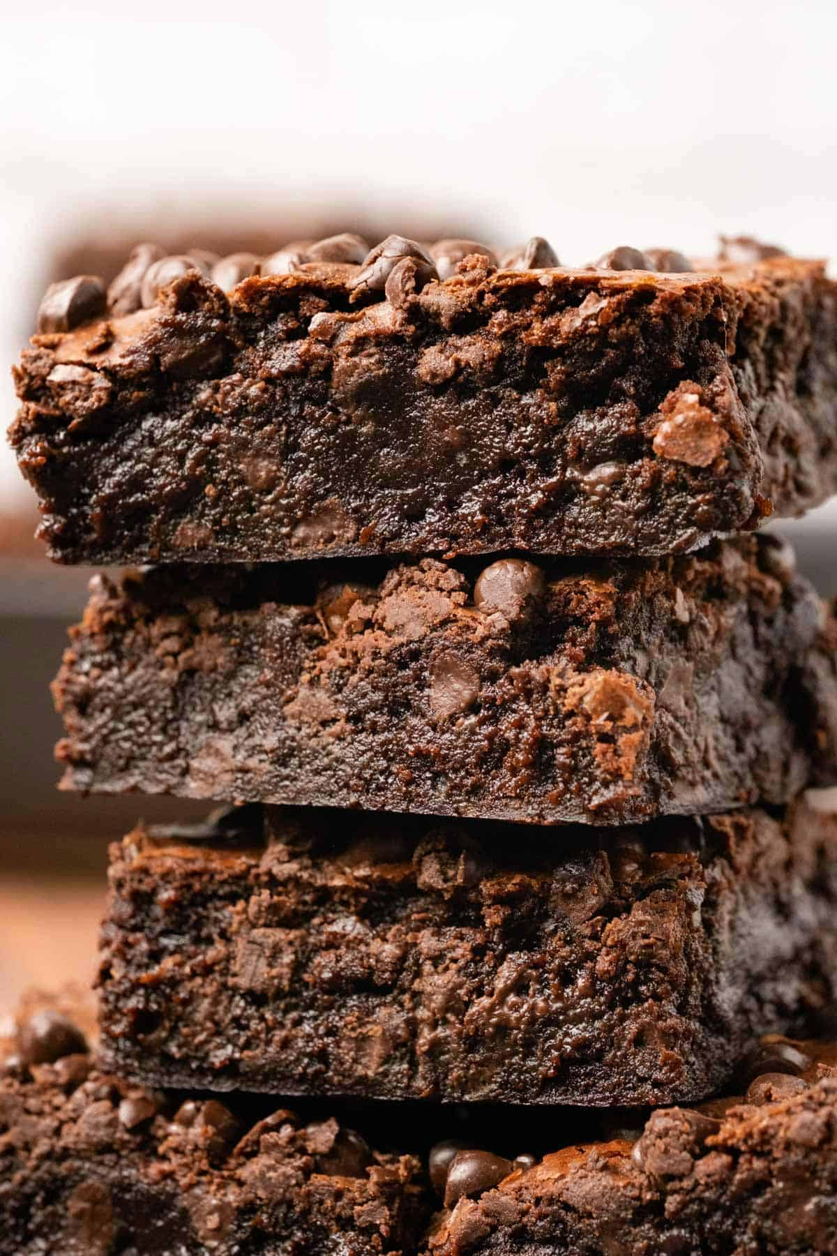 Brownies stacked up on top of each other.