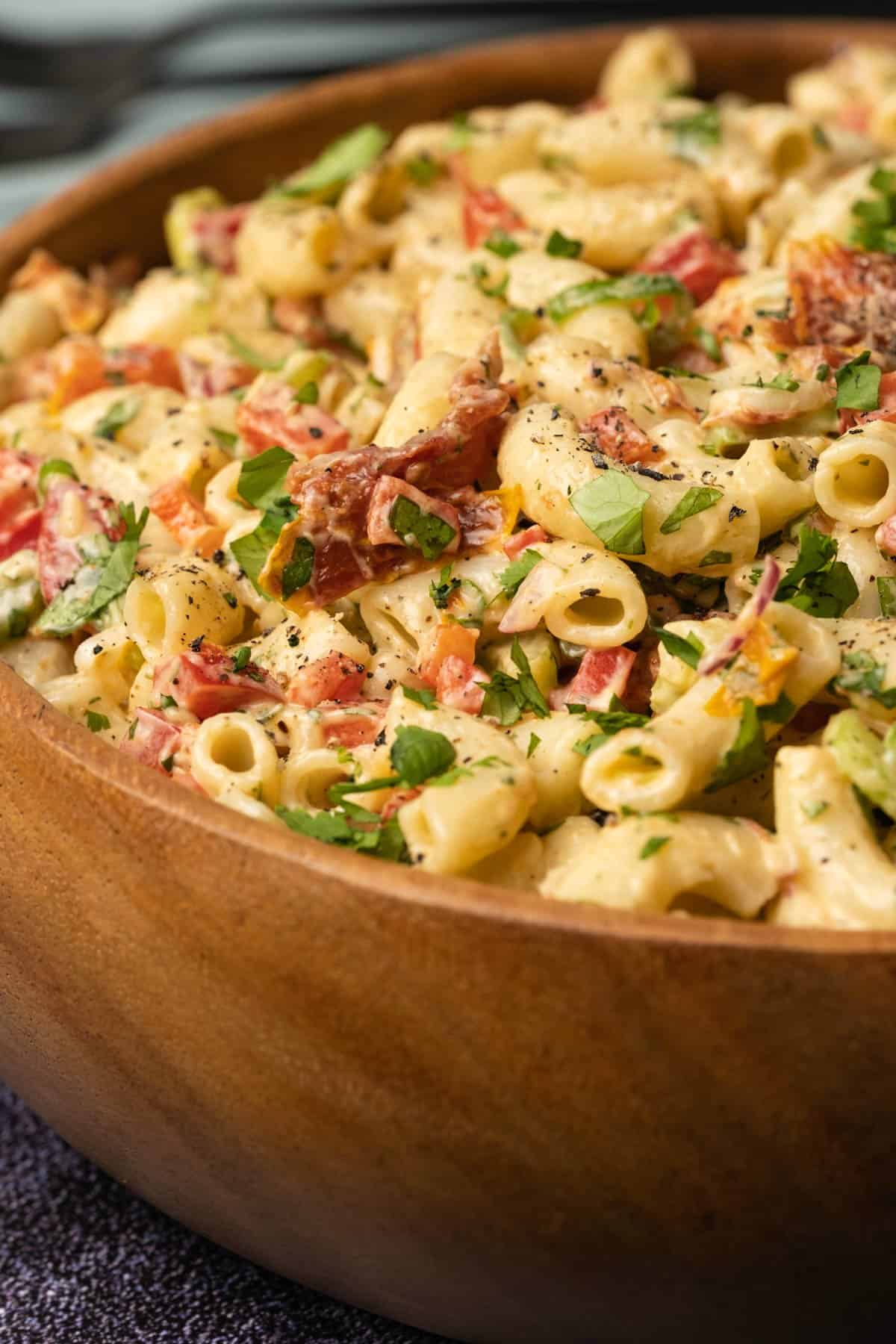 Macaroni salad in a wooden salad bowl.