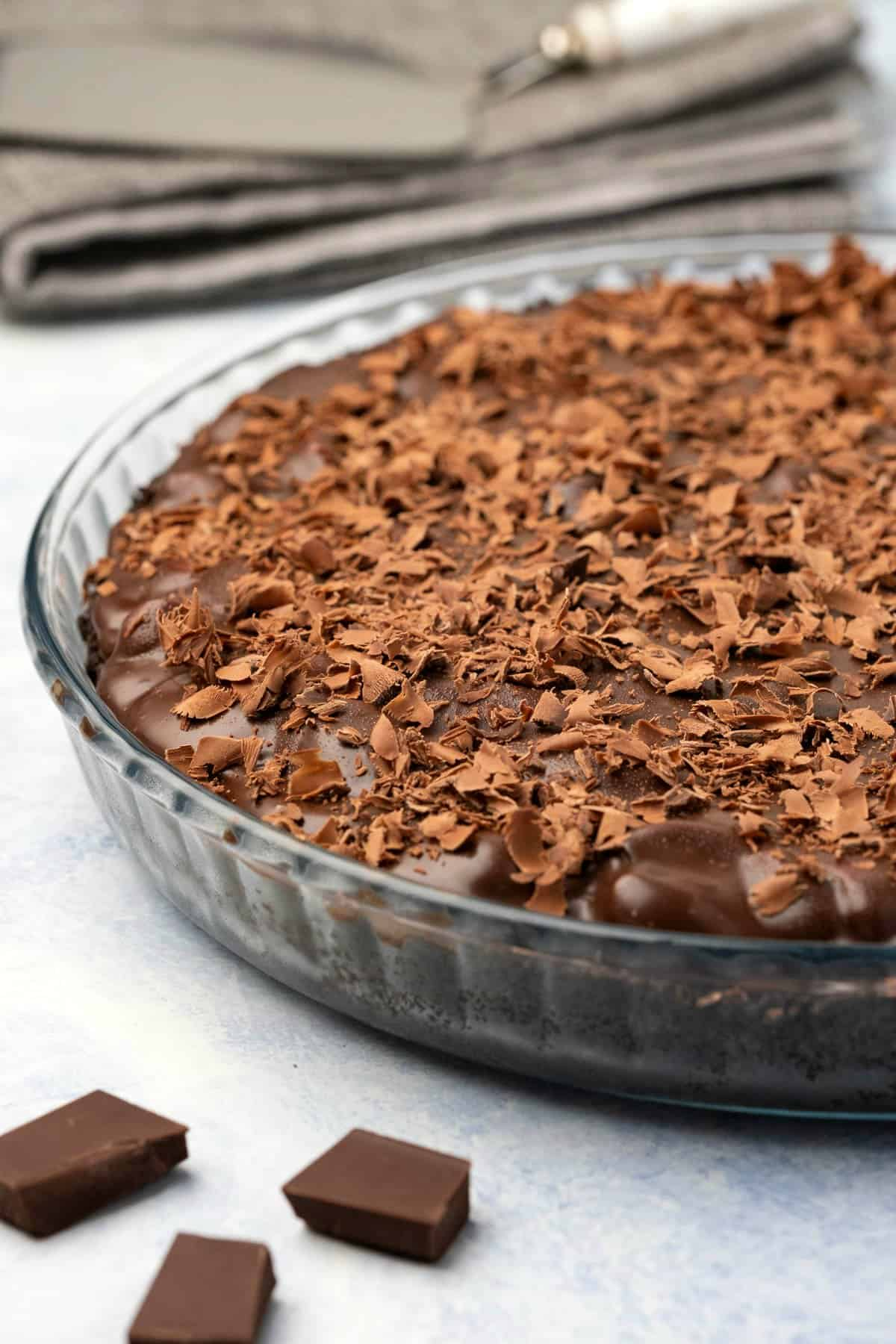 Chocolate tart in a glass dish.
