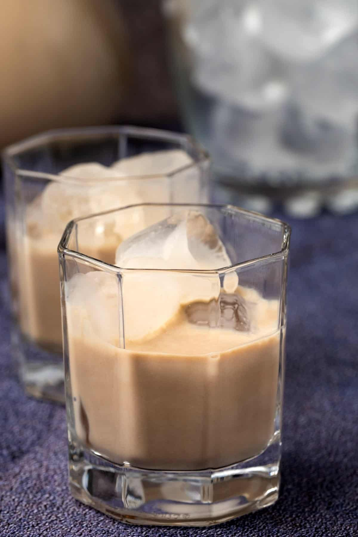 Homemade Irish cream in a glass with ice.