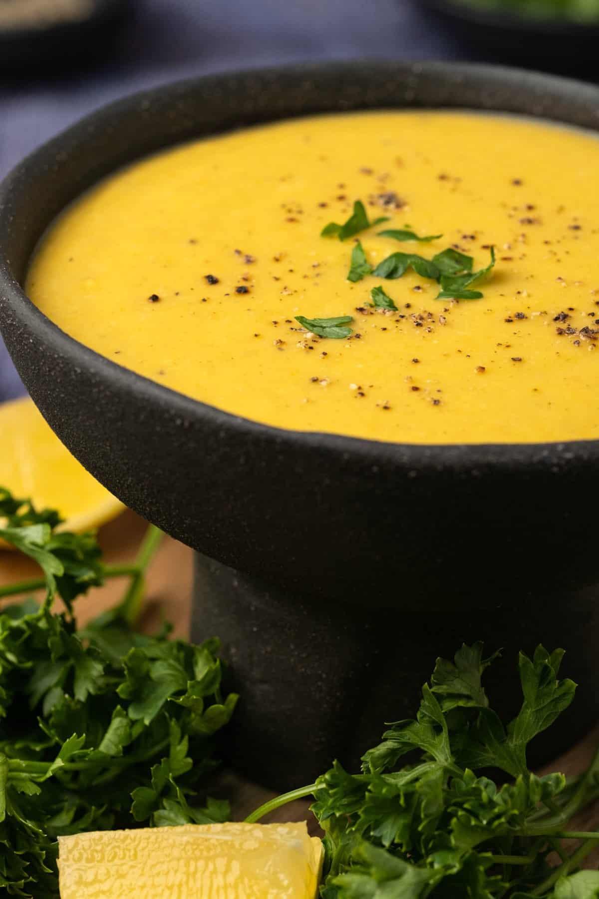 Middle eastern lentil soup in a black bowl.