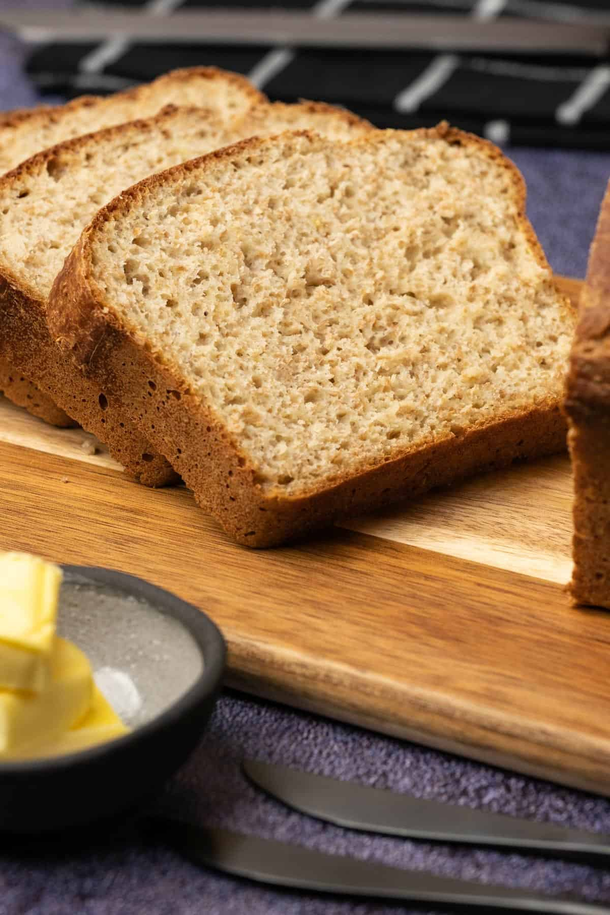 Homemade bread slices on a wooden board.
