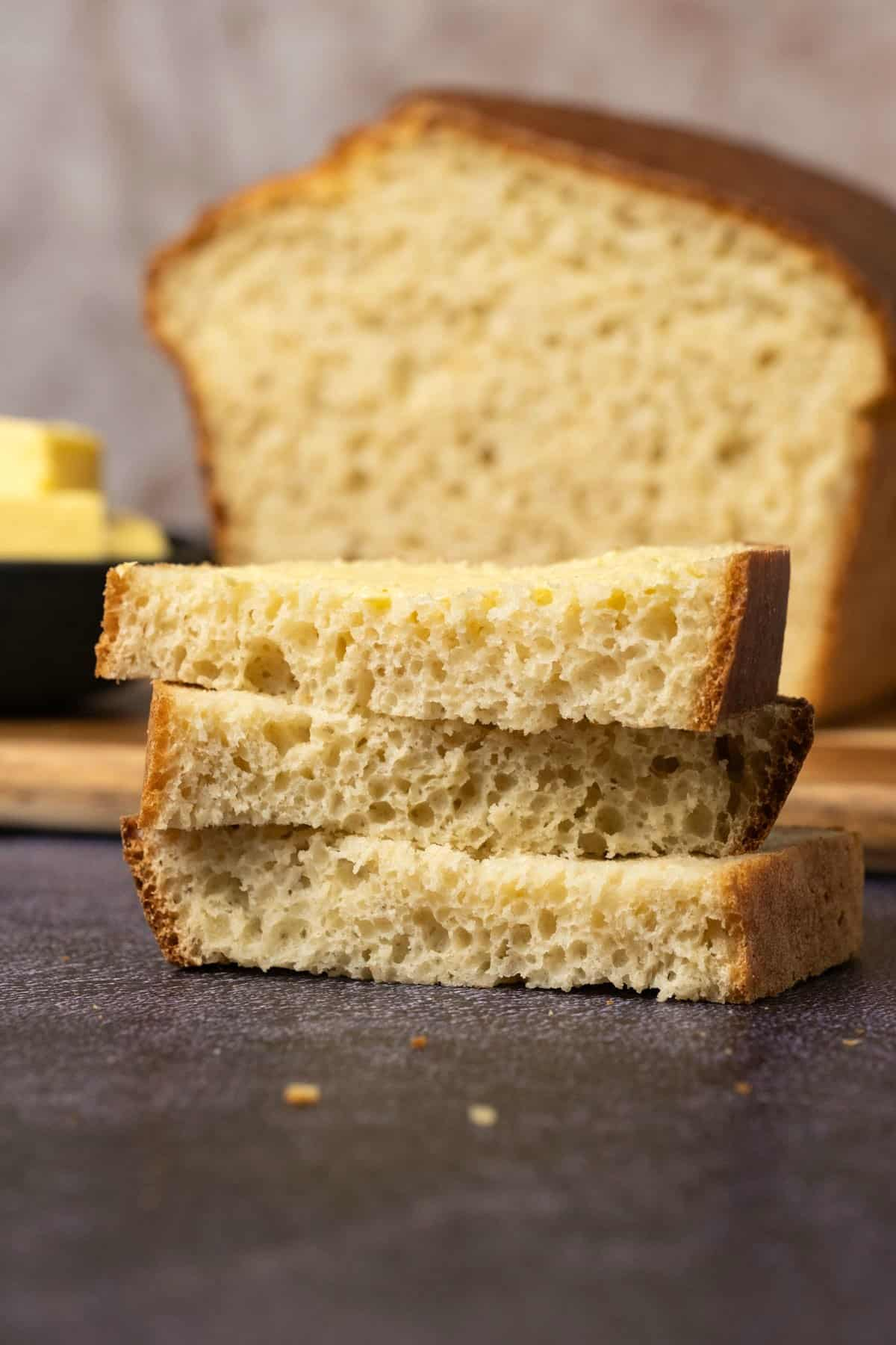 Slices of buttered white bread in a stack.