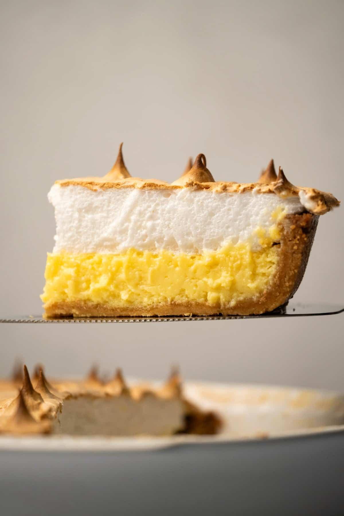 Slice of lemon meringue pie on a cake lifter.