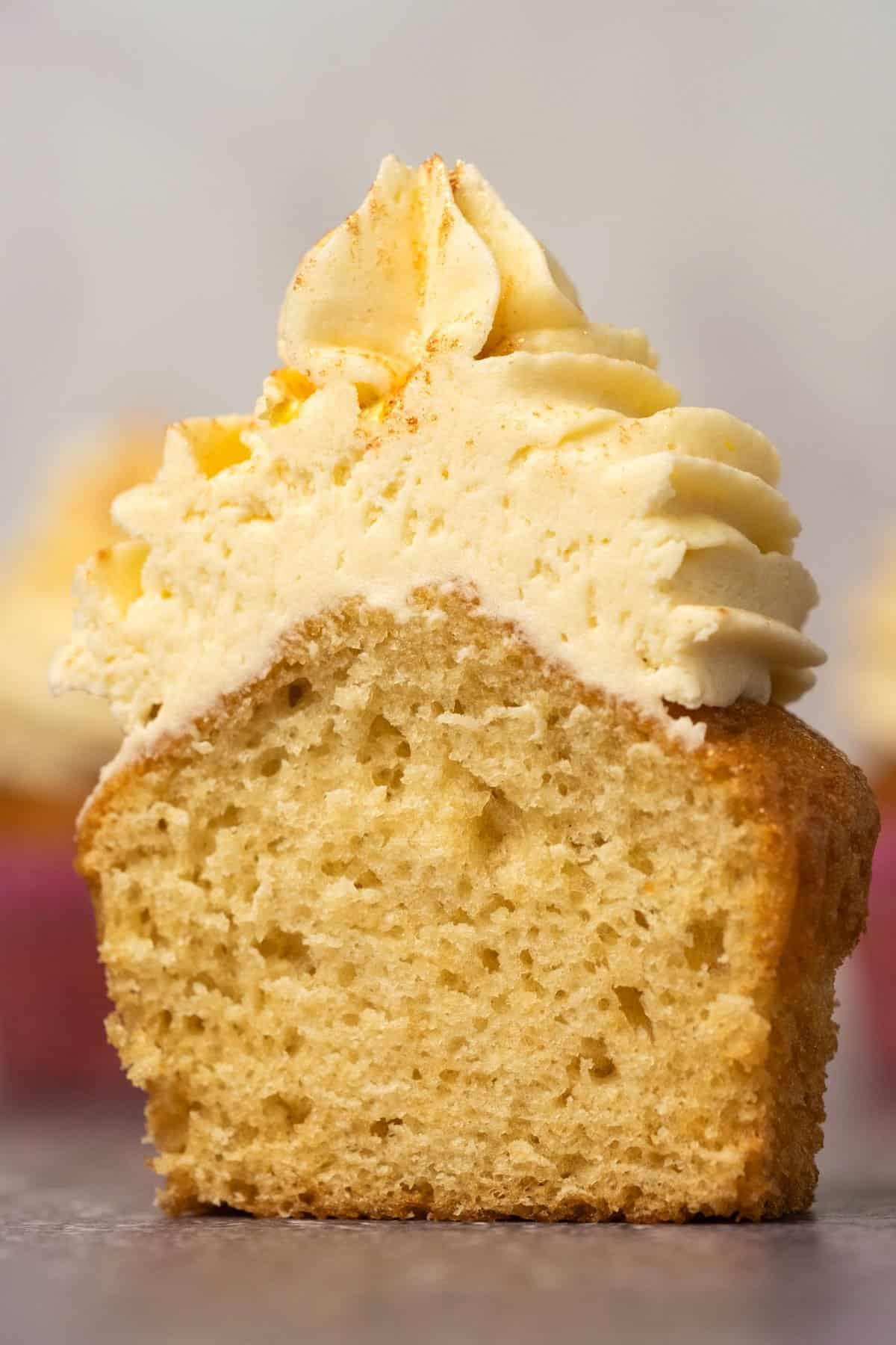 Vanilla cupcake cut in half to show the center.