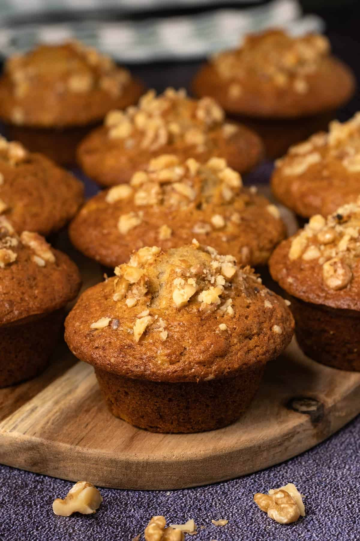 Banana muffins on a wooden board.