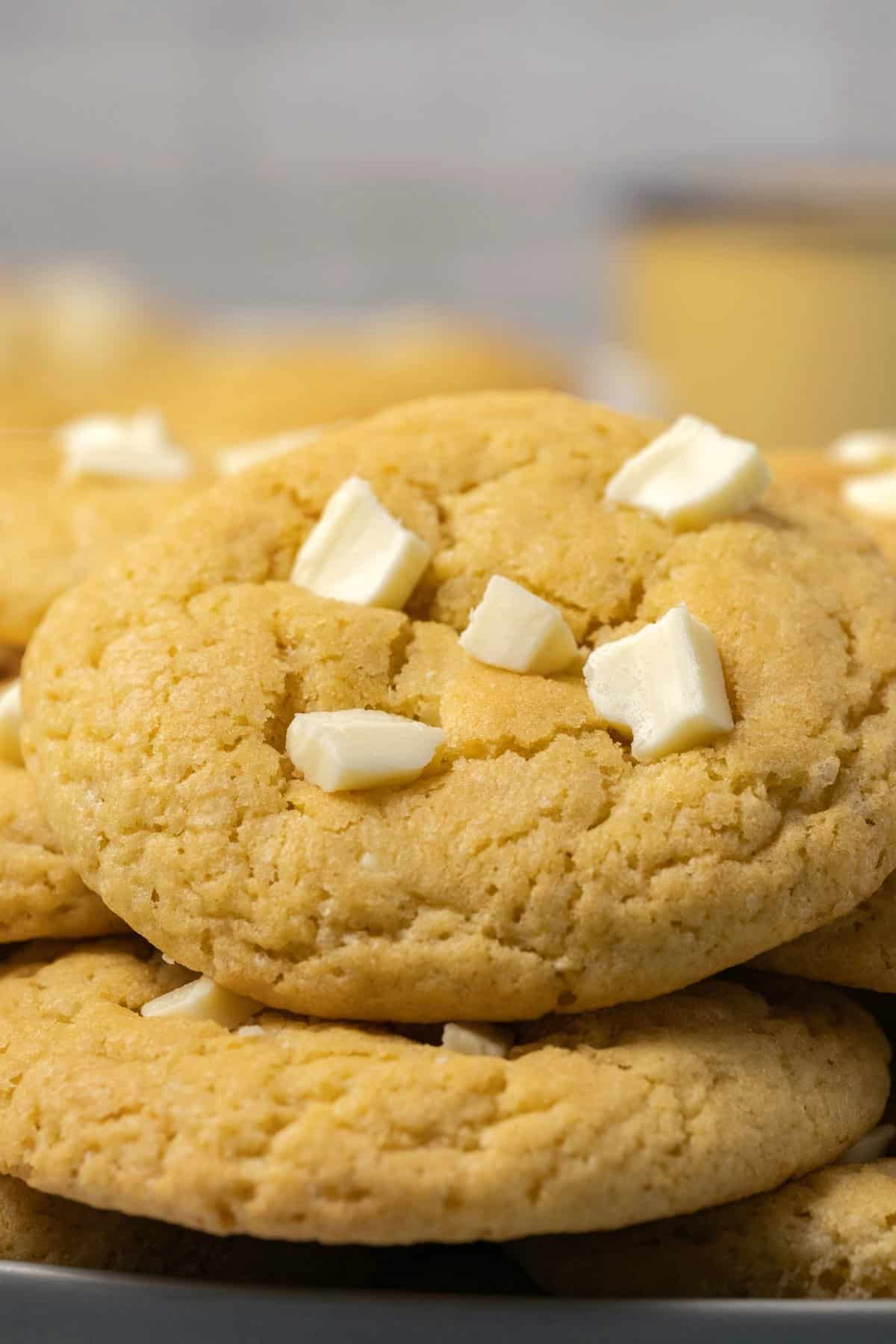 White chocolate chip cookies on a plate.