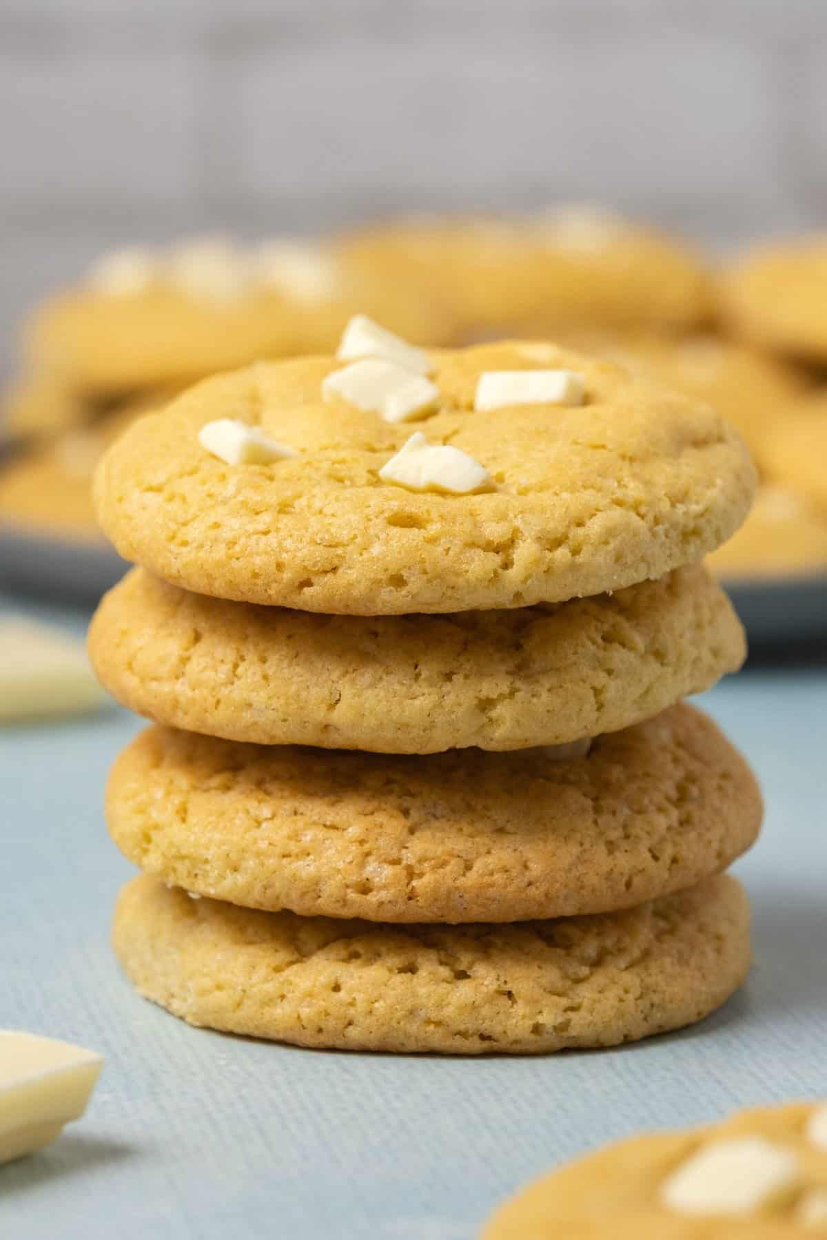 A stack of four white chocolate chip cookies.