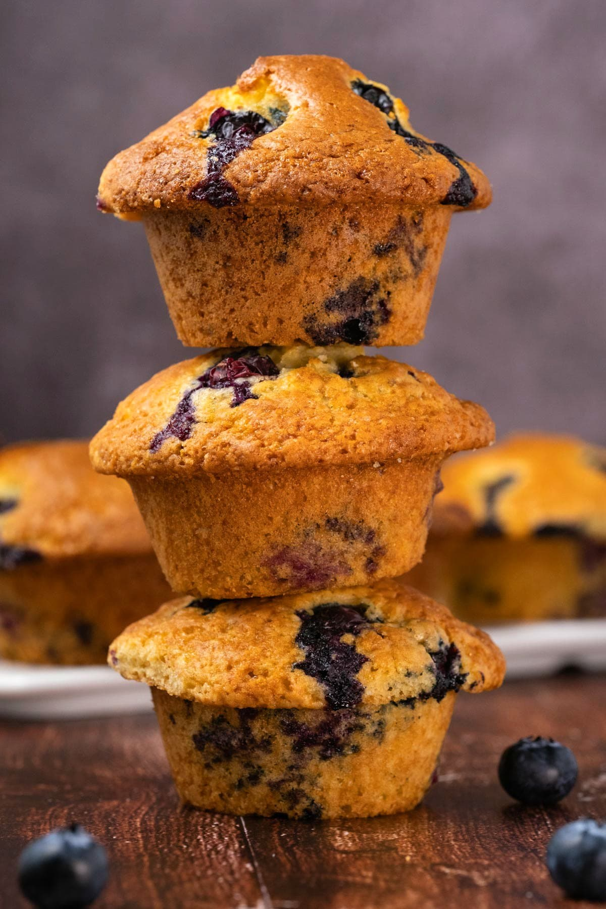 Blueberry muffins in a stack.