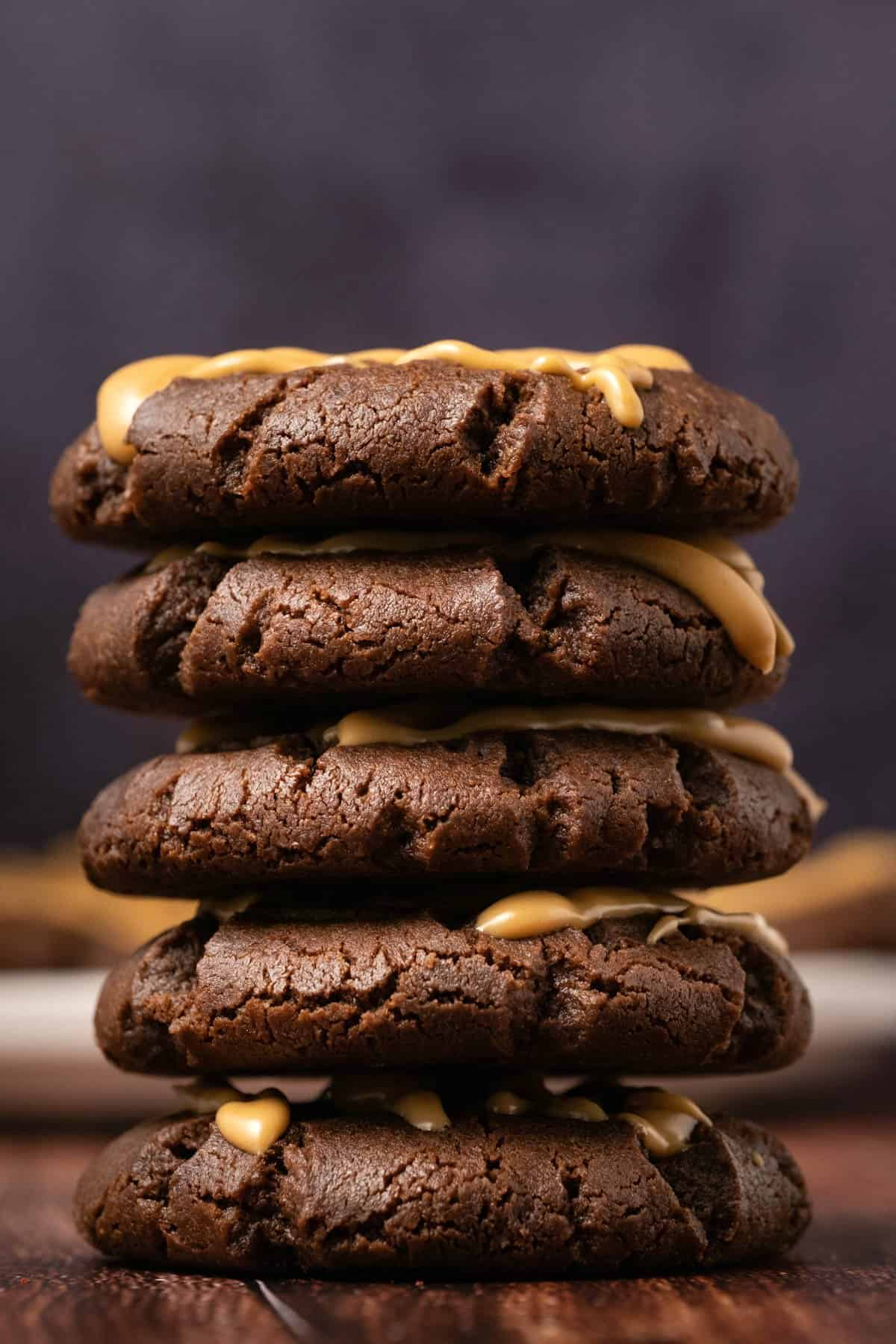 Chocolate peanut butter cookies in a stack.