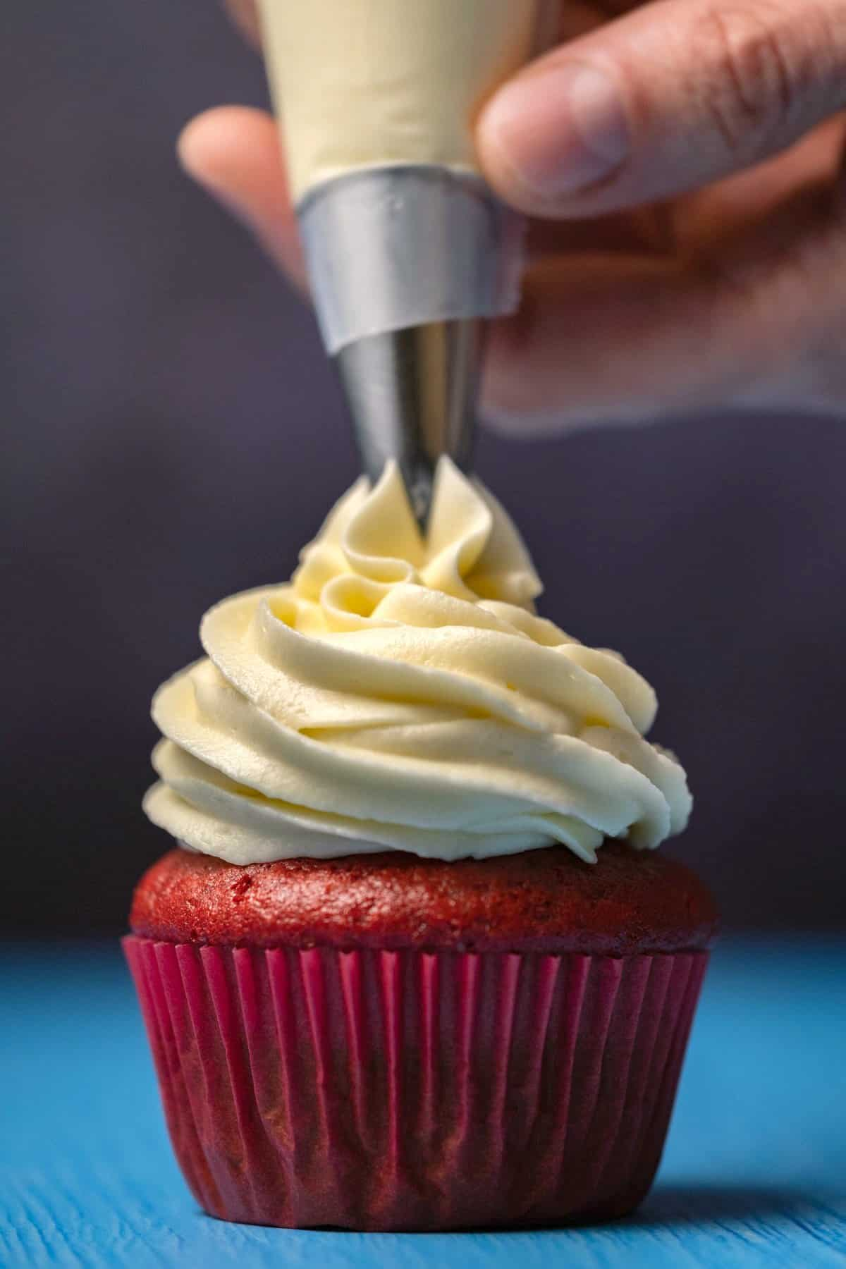 Frosting piping onto a cupcake.
