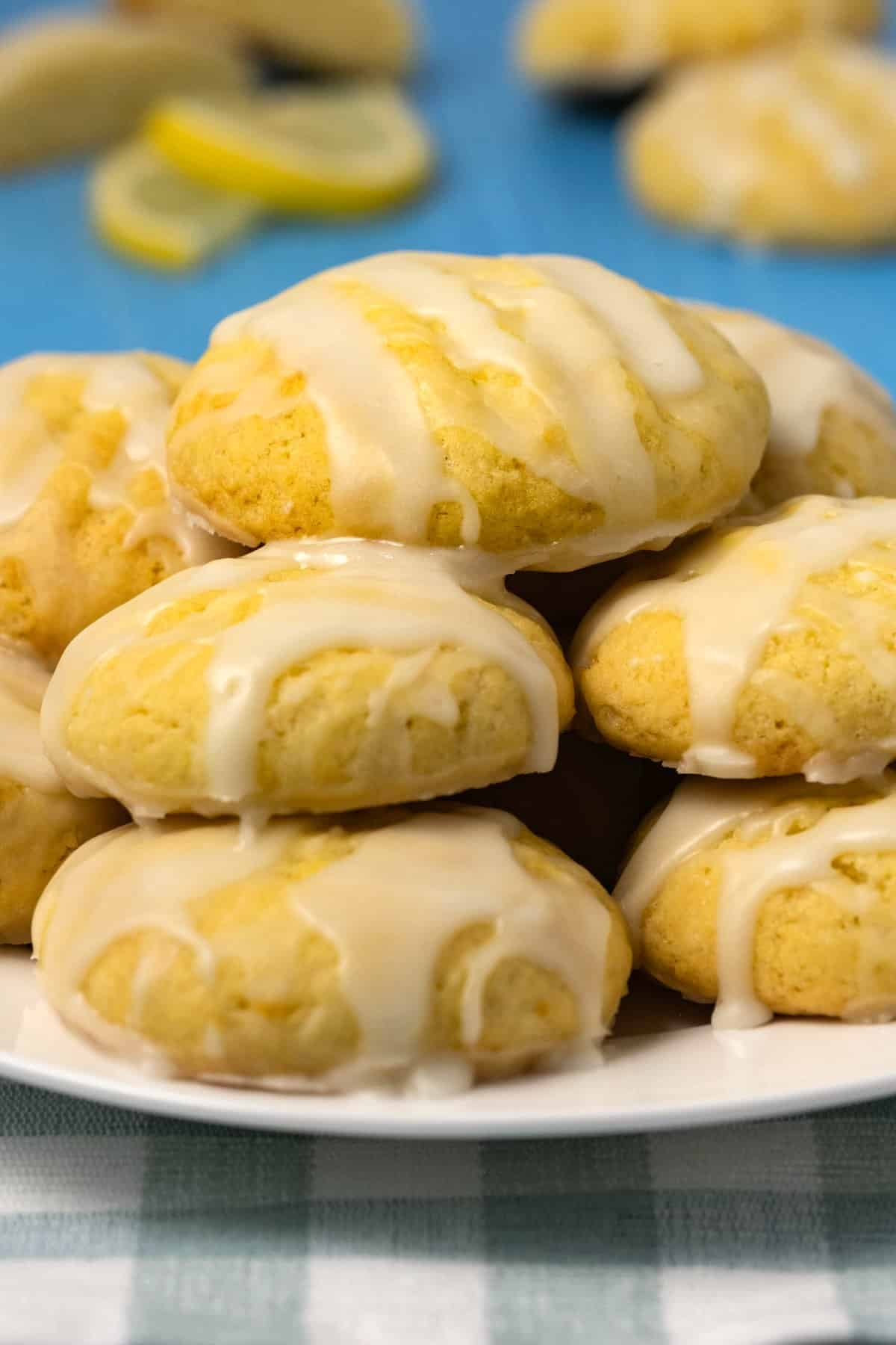 A stack of lemon cookies on a white plate.
