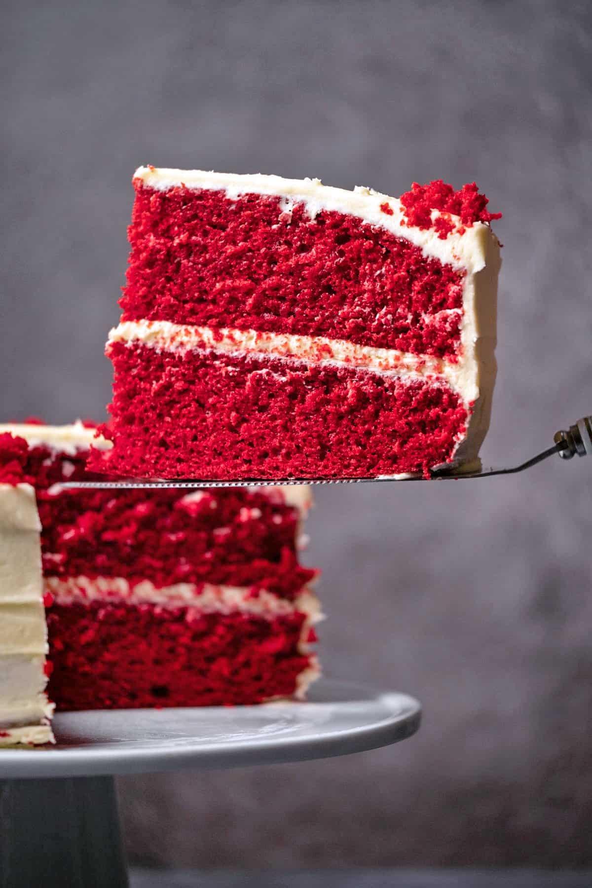 Slice of red velvet cake on a cake lifter.