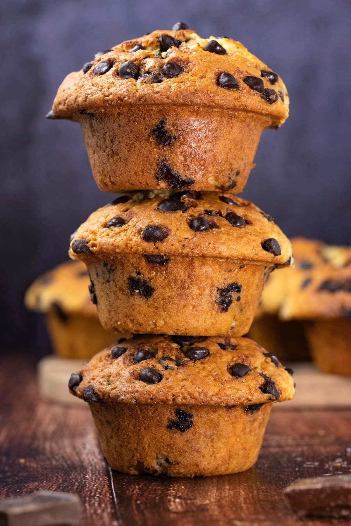 Chocolate chip muffins in a stack.