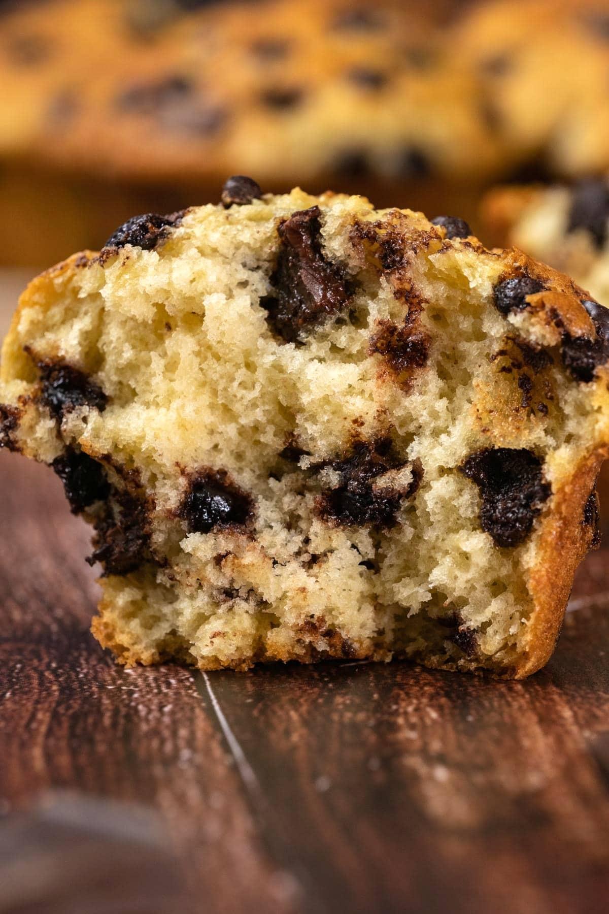 Chocolate chip muffin broken in half.