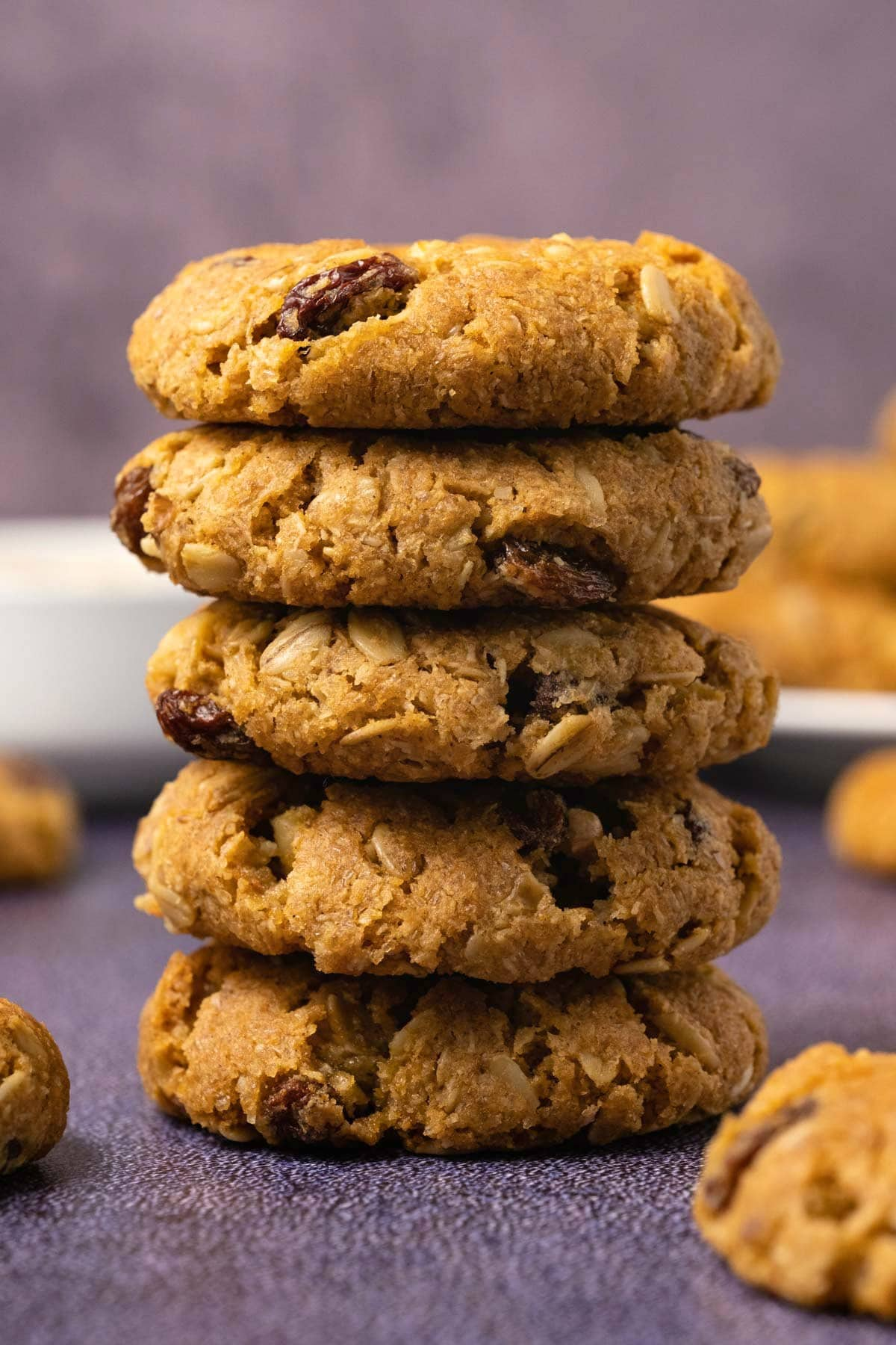 Oatmeal raisin cookies in a stack.