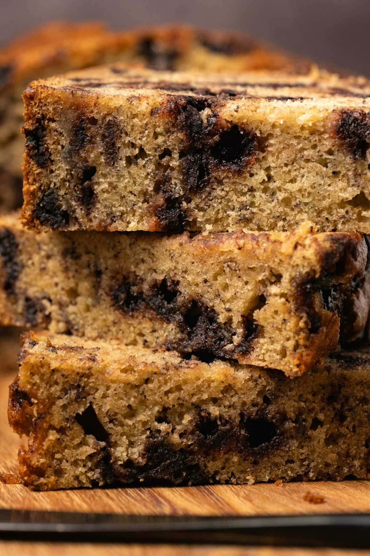Slices of chocolate chip banana bread cut in half and stacked up.