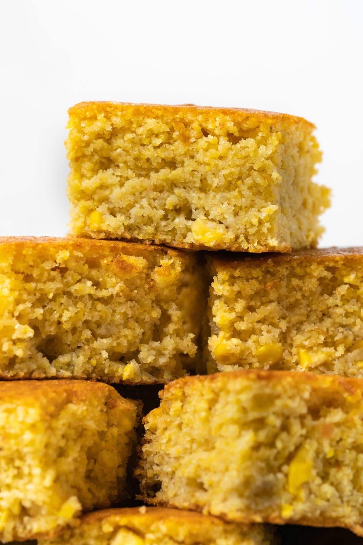 Squares of cornbread stacked up on top of each other.
