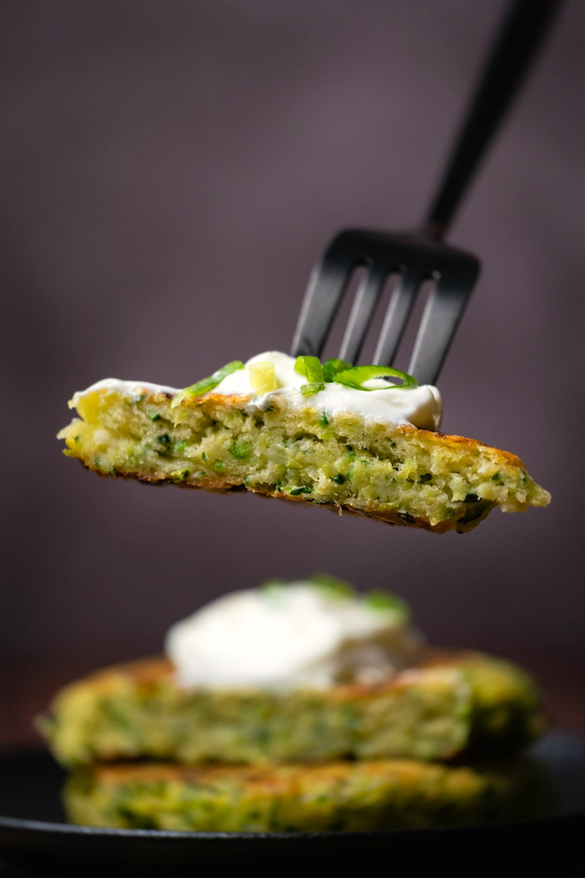 Forkful of zucchini fritters.