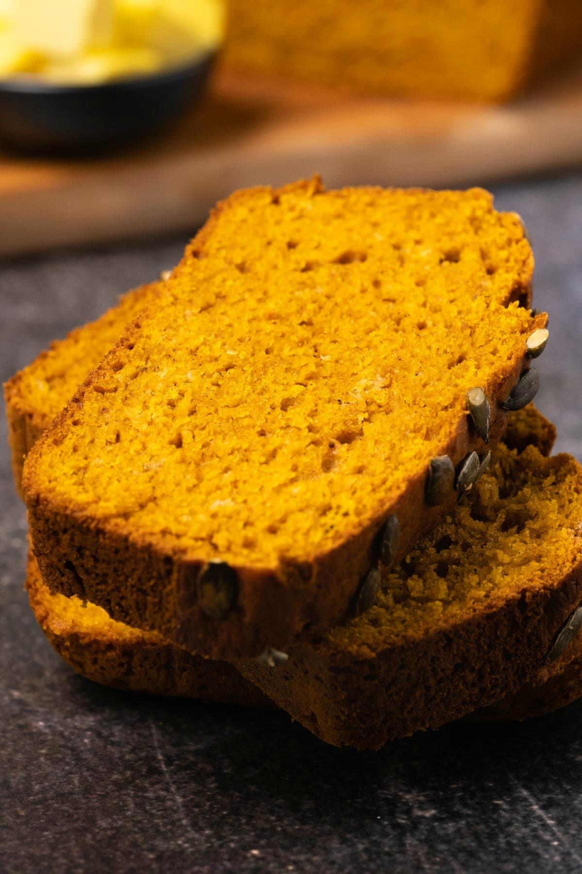 Slices of pumpkin bread in a stack.
