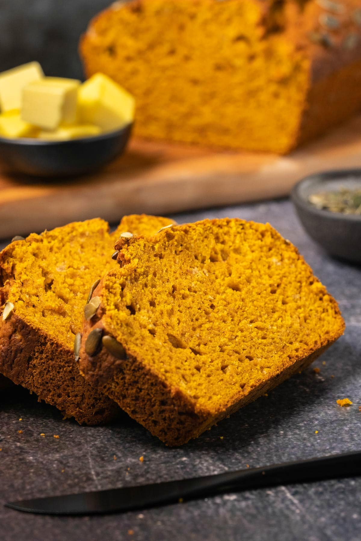 Slices of pumpkin bread in a row.