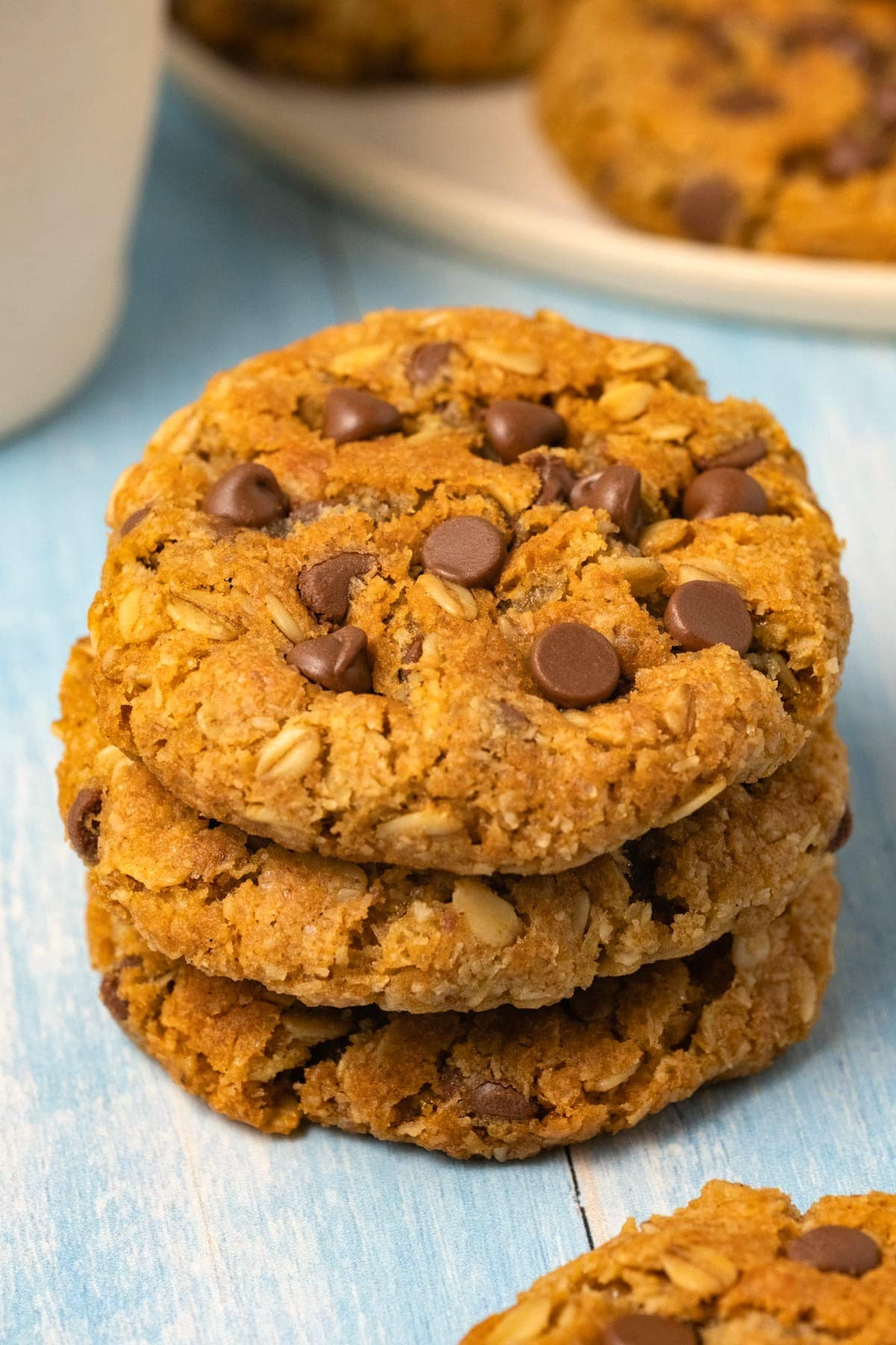Oatmeal chocolate chip cookies in a stack of three.