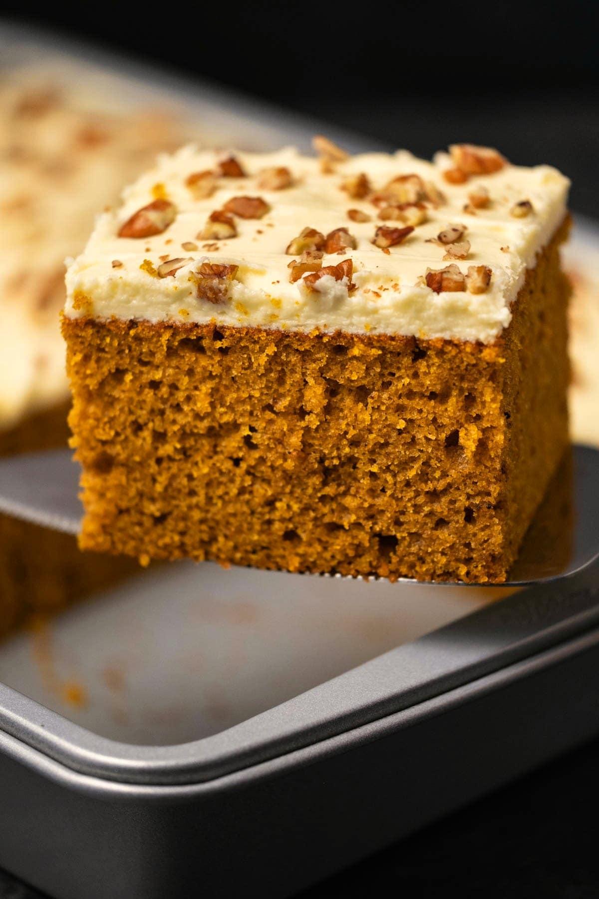 Slice of pumpkin cake on a cake lifter.