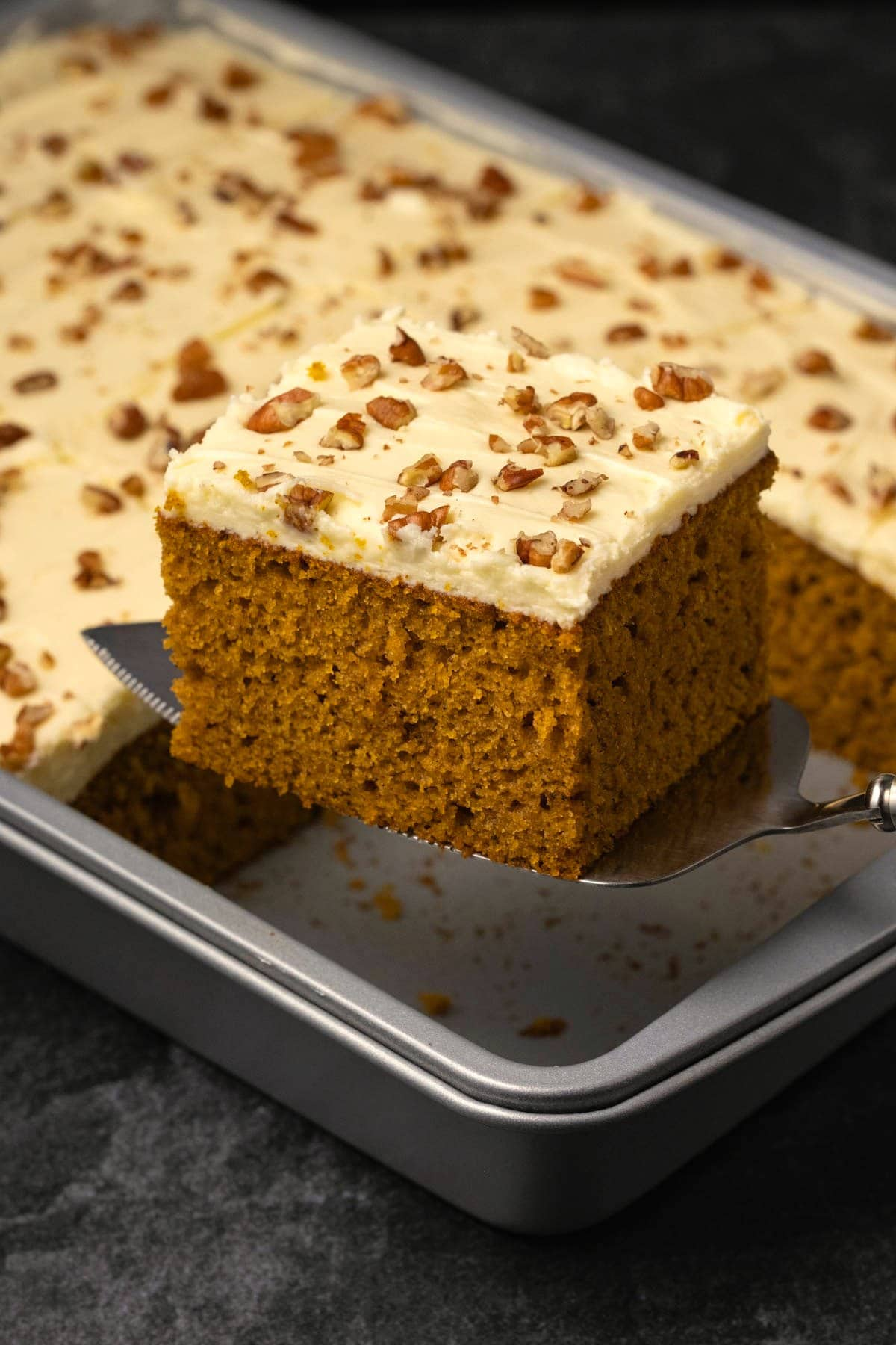 Slice of pumpkin cake on a cake lifter ready to serve.