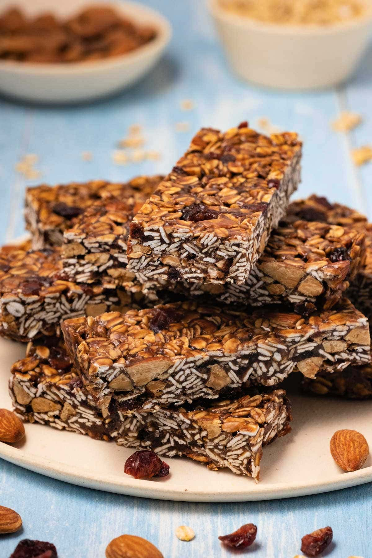 Granola bars stacked up on a plate.