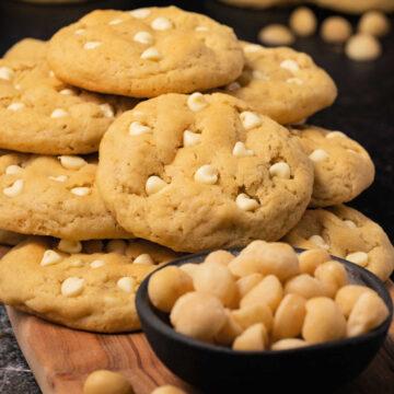 Macadamia nut cookies on a wooden board.