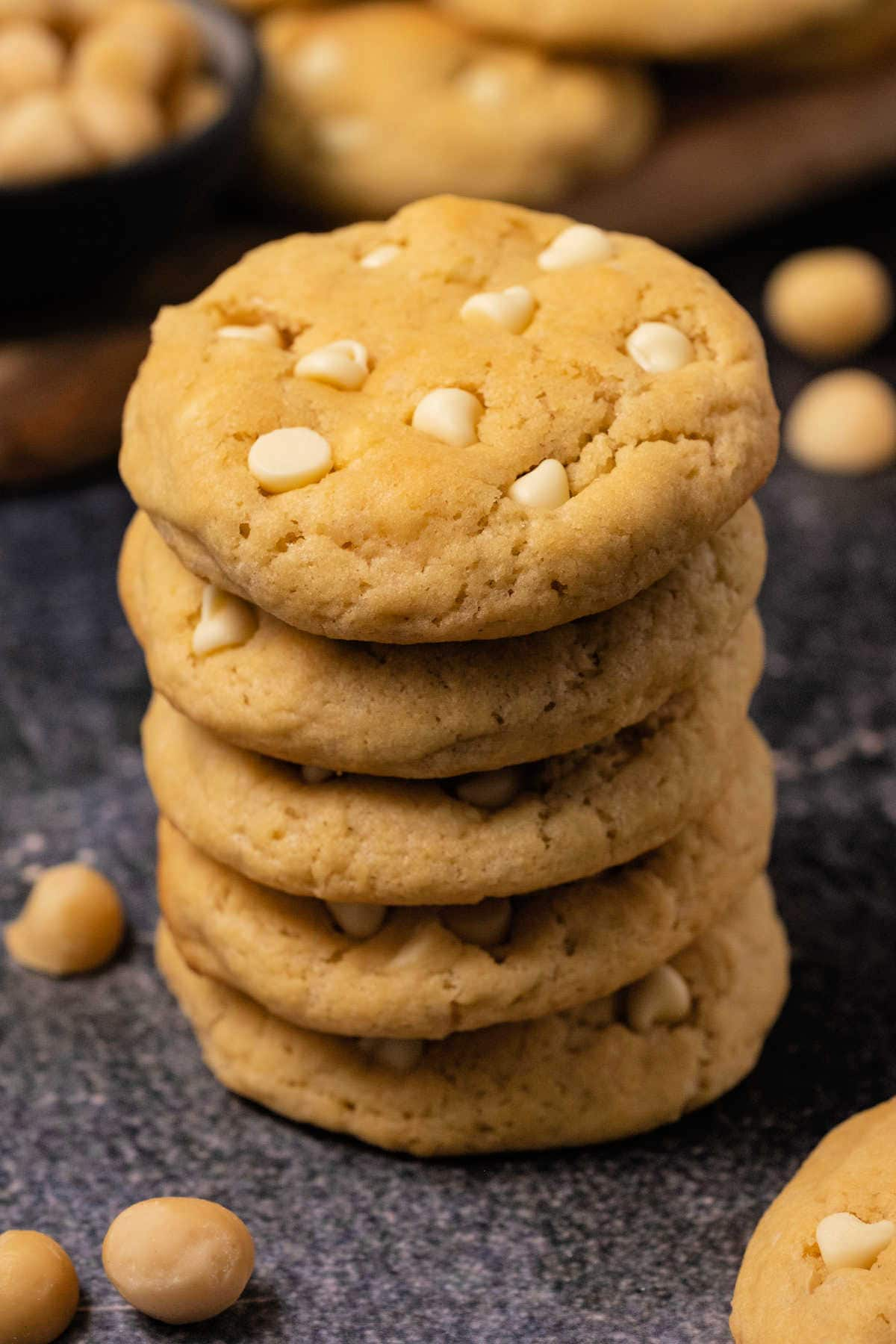 White chocolate macadamia nut cookies in a stack.