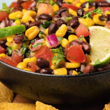 Black bean salsa with fresh lime in a black bowl