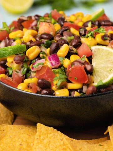 Black bean salsa with fresh lime in a black bowl