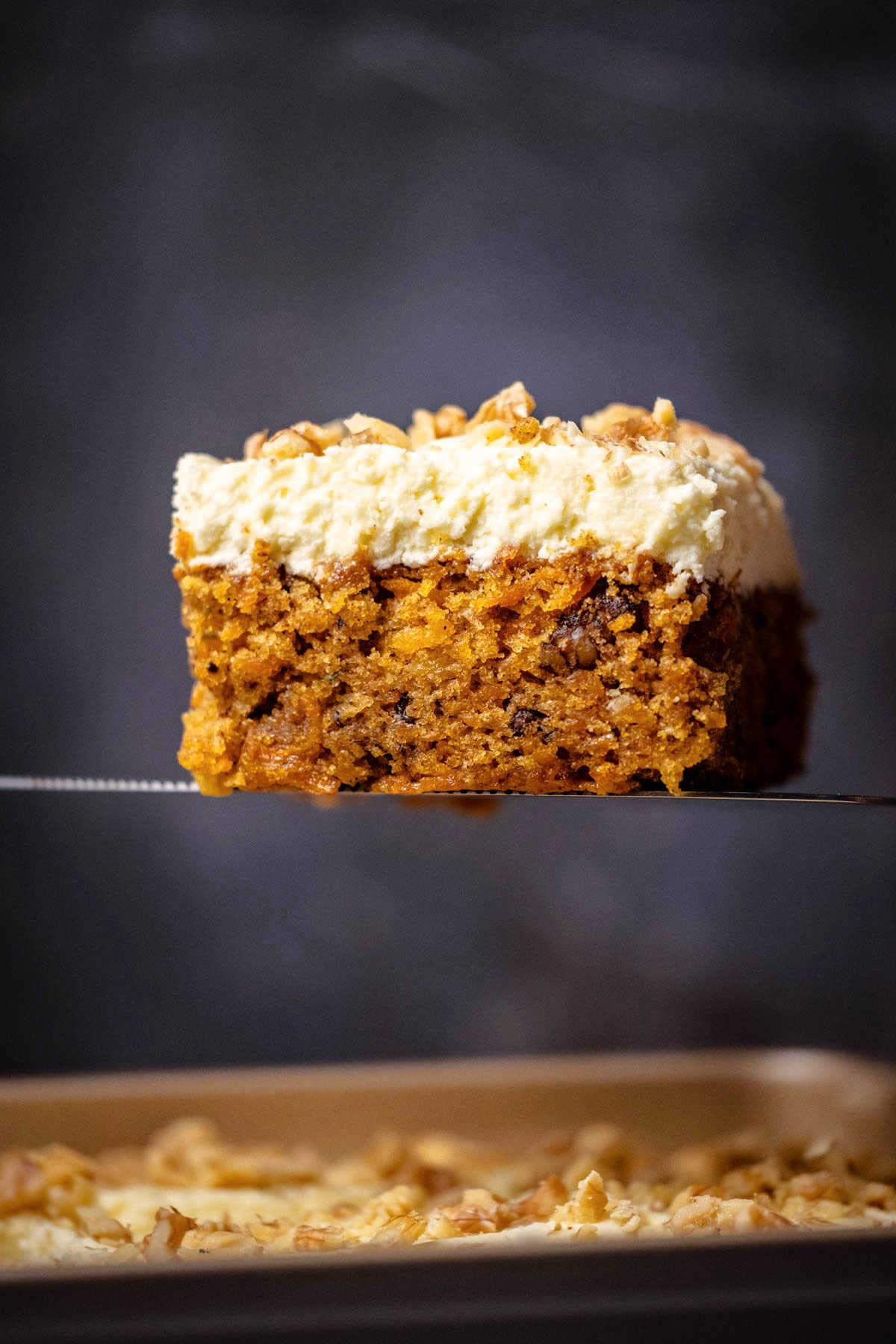 Slice of carrot cake on a cake lifter.