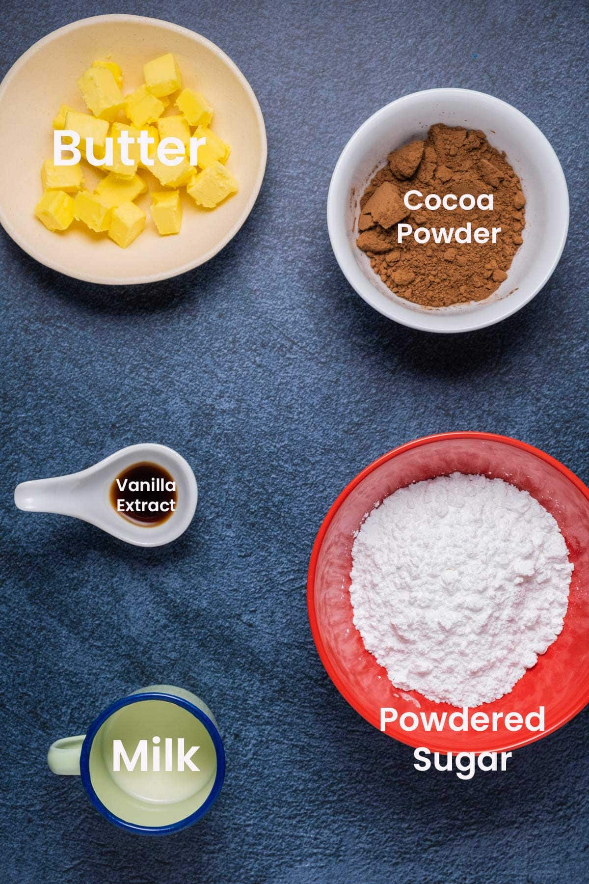 Ingredients to make a small batch of chocolate buttercream frosting.