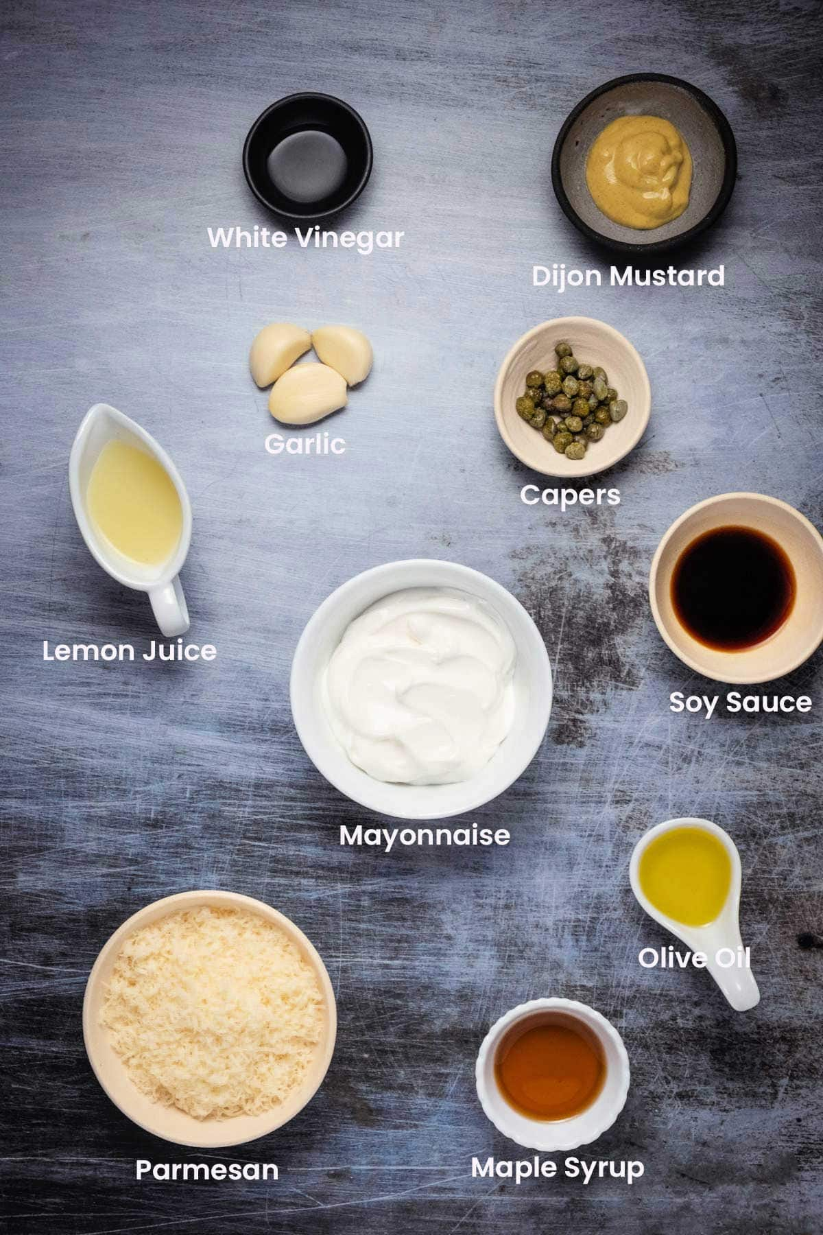 Photo of the ingredients needed to make a vegetarian caesar dressing.