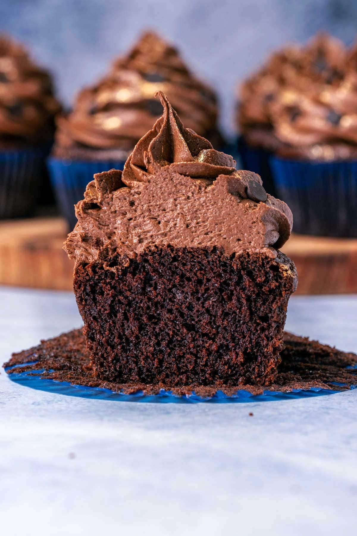 Eggless chocolate cupcake cut in half.