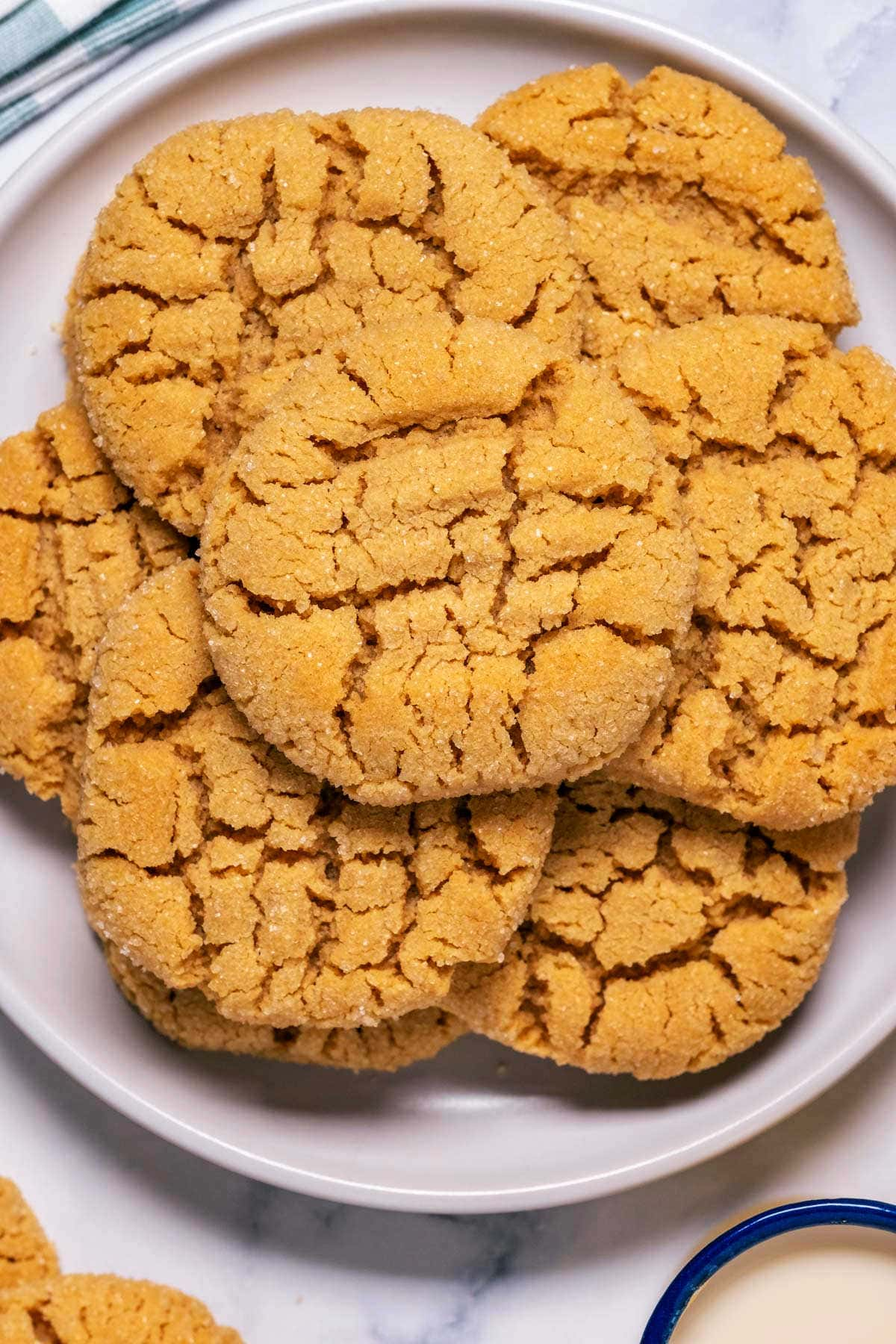 Eggless peanut butter cookies on a white plate.