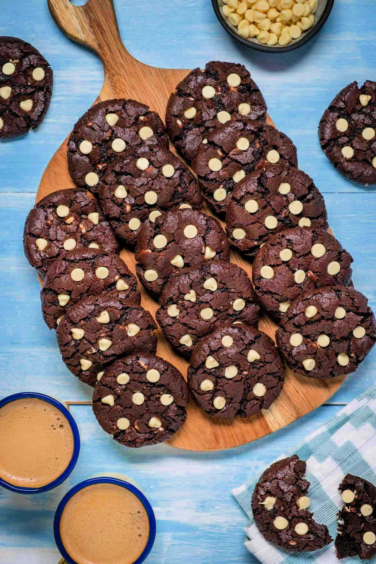 Inside out chocolate chip cookies lined up on a wooden board.