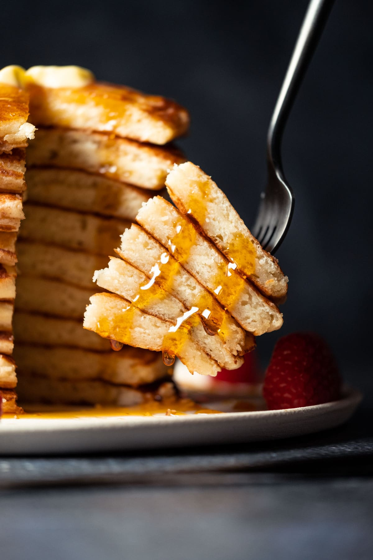 Cut stack of pancakes on a fork.