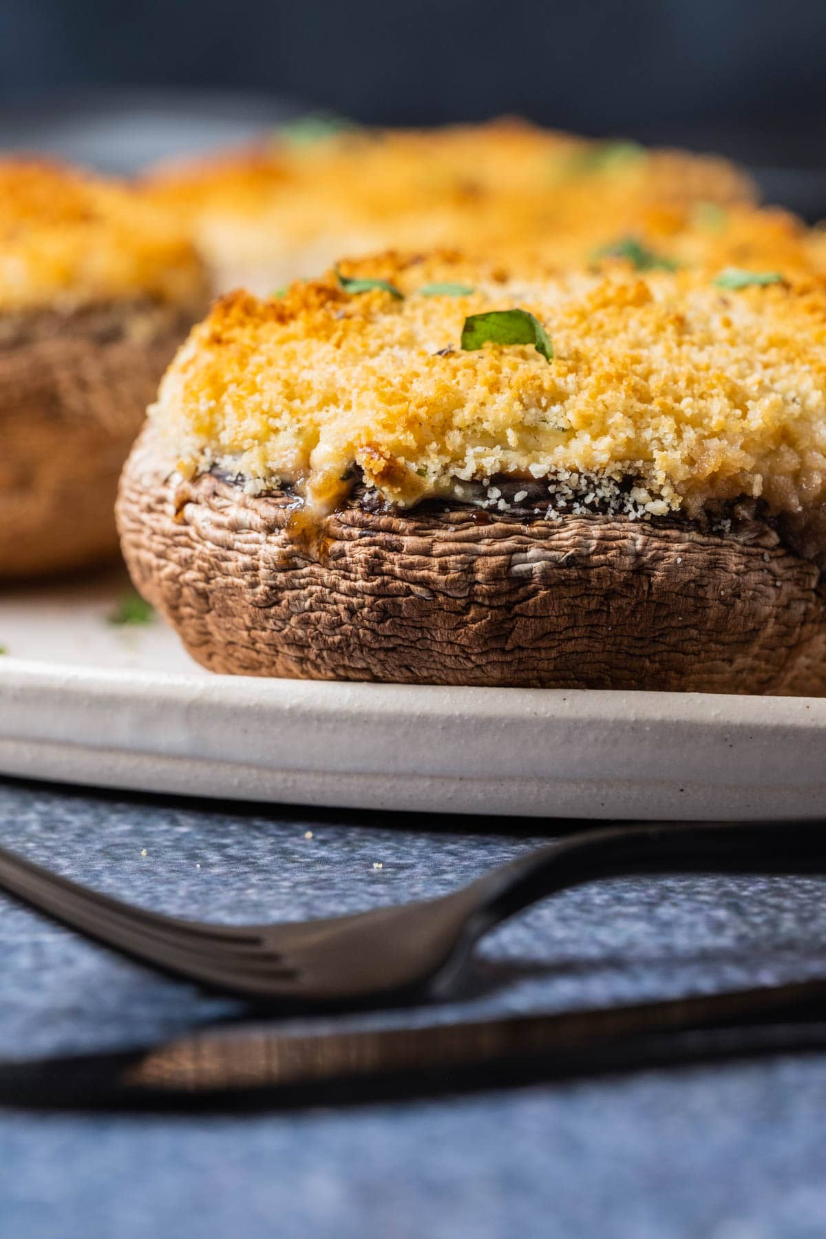 Vegetarian stuffed mushrooms on a white plate.