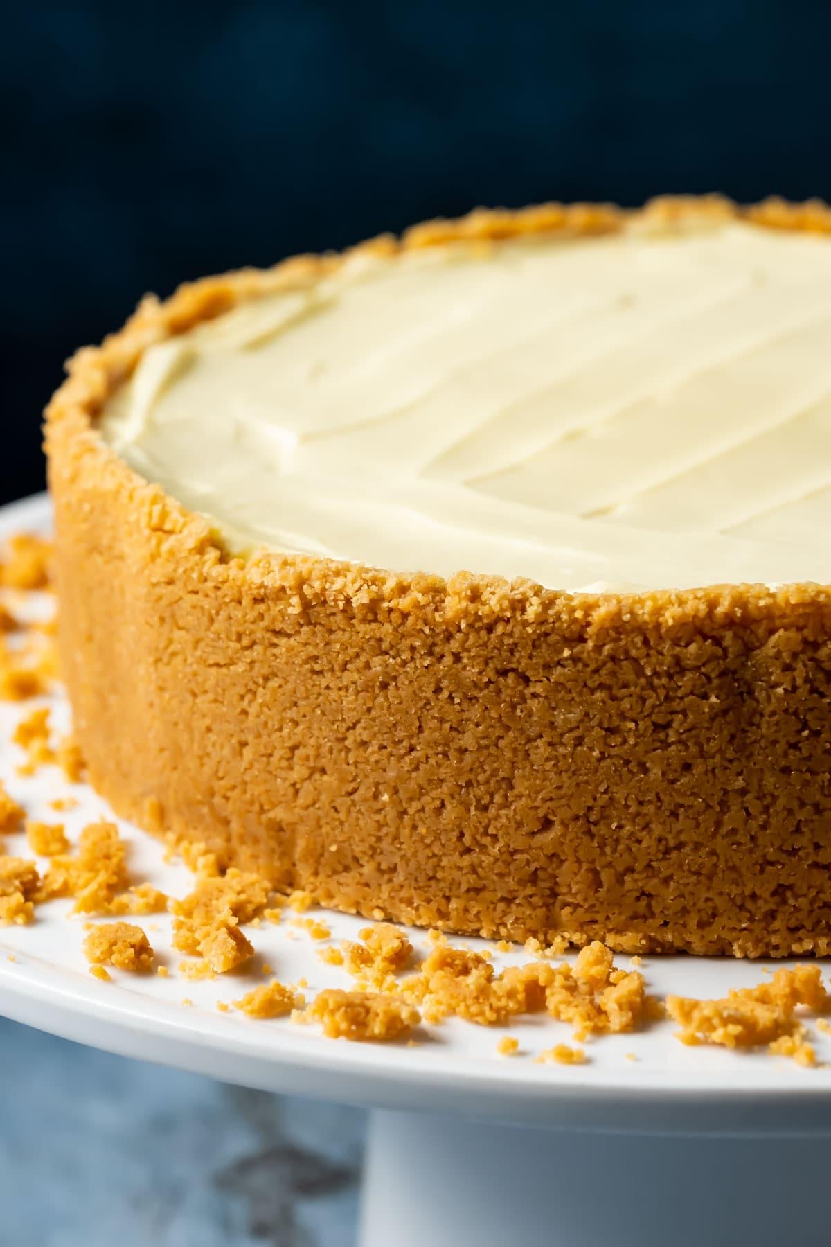 Eggless cheesecake on a white cake stand.