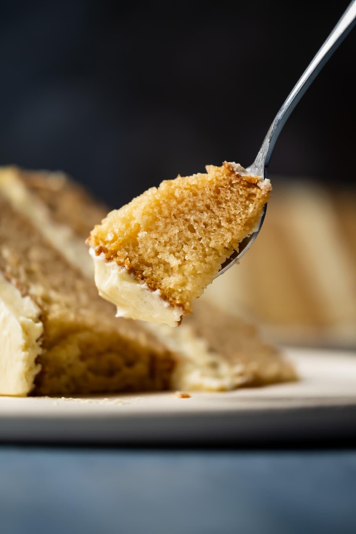 Forkful of eggless vanilla cake.
