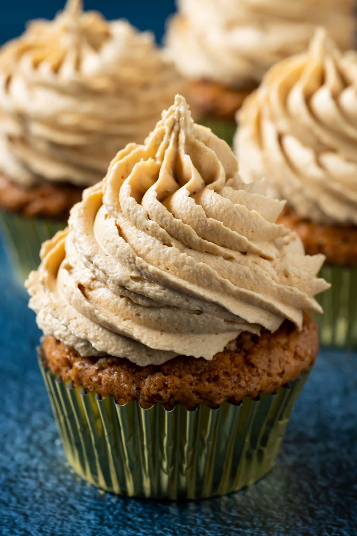 Cupcakes topped with biscoff buttercream.