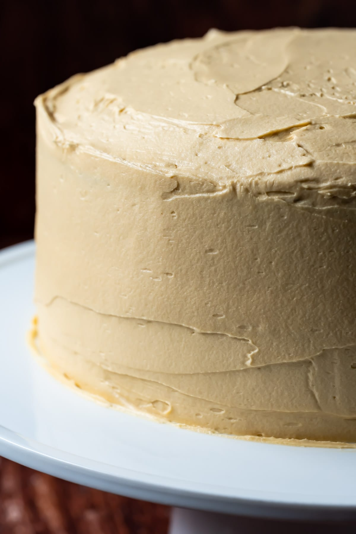 Espresso buttercream frosting spread on a cake.